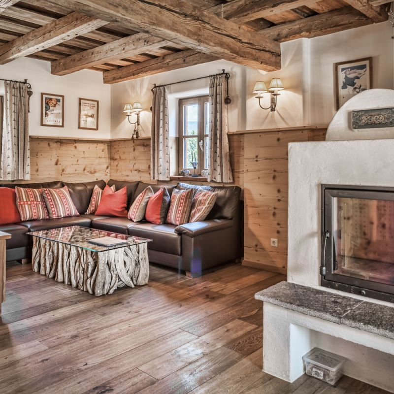 Self-catered chalet with relaxing living and dining area with wood fireplace – st martin chalets